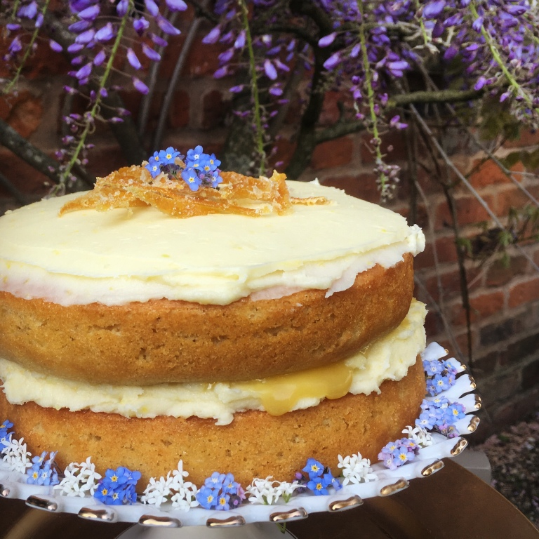 royal wedding lemon and elderflower cake decorated with fresh forget-me-not flowers