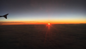sunset in the clouds - view from aeroplane window
